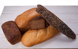 Tasty rustic bread on wooden table Royalty Free Stock Images