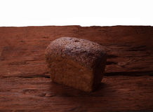 Tasty rustic bread on wooden table Royalty Free Stock Photo