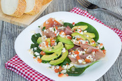 Salad with avocado, jamon and spinach Stock Photography