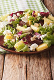 Tasty salad of beets, pineapple, cream cheese, cashews and green Stock Photo