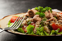 Tasty salad with couscous, tuna and vegetables Royalty Free Stock Images