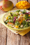 Tasty salad of grilled chicken breast, mango, arugula, lettuce a Royalty Free Stock Photography