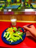 Tasty Salad. A plate of tasty salad on a lunch counter at a cafeteria Royalty Free Stock Photos