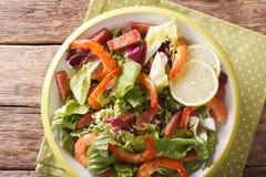 Tasty salad of shrimp, chorizo sausage and mix lettuce close-up. Stock Image