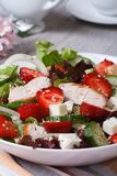 Tasty salad of strawberries with chicken and vegetables. Close-up. vertical Stock Photos