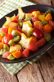 Tasty salad of tropical fruits close-up on a plate. vertical Royalty Free Stock Image