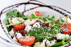 Tasty salad. Salad of vegetables and meat on dish Royalty Free Stock Image
