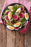Tasty salad of watermelon radishes, eggs, spinach and herbs clos Royalty Free Stock Photography