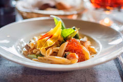 Tasty salmon penne Stock Images