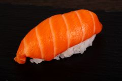 Tasty salmon sushi. Tasty traditional japanesse salmon sushi stock photography