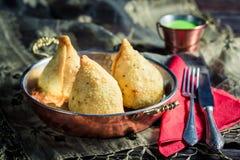 Tasty samosa with dip Royalty Free Stock Image
