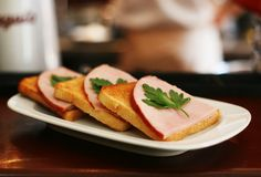 Tasty sandwich with bacon and fennel on the plate Royalty Free Stock Image