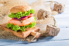 Tasty sandwich with fish and vegetables Stock Images