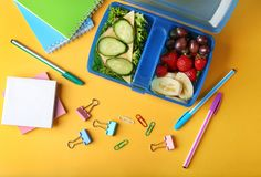 Tasty sandwich and fruits in lunchbox and stationery Stock Photo