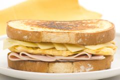 Tasty sandwich of ham and cheese omelet Stock Photos