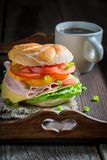 Tasty sandwich with ham, cheese and tomatoes Royalty Free Stock Image