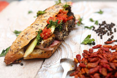Tasty sandwich with savory fillings Stock Photography
