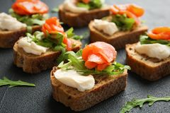 Tasty sandwiches with fresh sliced salmon fillet. On table stock photography