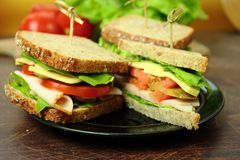 Tasty sandwiches. Sandwiches with ham cheese and lettuce Royalty Free Stock Images