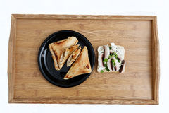 Tasty sandwiches with mashrooms. Tasty sandwiches with savory fillings on a vintage piece of wood, hot Royalty Free Stock Images