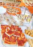 Tasty sandwiches and pizza on the table of restaurant for weddin Stock Image
