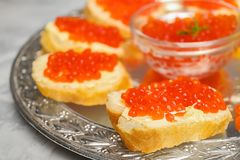 Tasty sandwiches with red caviar. On vintage metal tray, closeup Royalty Free Stock Image