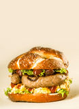 Tasty Sausage Burger with Fresh Veggies and Sauce Royalty Free Stock Image