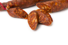 Tasty sausage sliced sausage on isolated background Royalty Free Stock Images