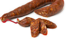 Tasty sausage sliced sausage on isolated background Stock Images