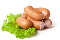 Tasty sausages. And lettuce isolation on white Stock Images