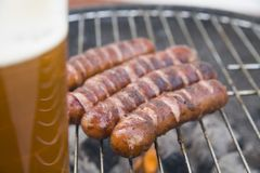 Tasty sausages with beer Royalty Free Stock Photography