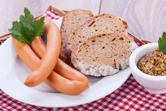 Tasty sausages frankfurter with grain bread Stock Images