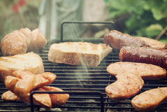 Tasty sausages on the grill Royalty Free Stock Photography