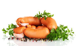 Tasty sausages, spices and parsley Royalty Free Stock Images