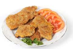 Tasty schnitzels on light background Stock Photography