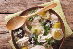 Tasty Scottish chicken soup with leeks and prunes close up in a Royalty Free Stock Images