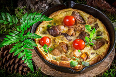 Tasty scrambled eggs with mushrooms Stock Photo