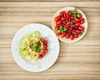 Tasty scrambled eggs with paprika, cherry tomatoes, chili pepper Royalty Free Stock Photography