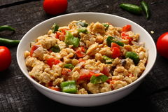 Tasty Scrambled eggs with vegetables Royalty Free Stock Photo