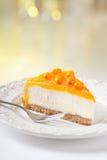 Tasty sea-buckthorn cake. Slice on beautiful plate Royalty Free Stock Photography