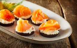 Tasty seafood canapes with smoked salmon Stock Photos