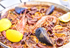 Tasty Seafood Paella in black pan -traditional spanish rice dish Royalty Free Stock Photos
