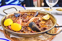 Tasty Seafood Paella in black pan -traditional spanish rice dish Stock Images