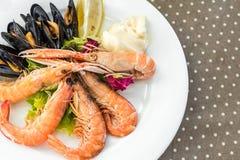 Tasty seafood on plate on table close-up, Siurana, Catalunya, Spain. Tasty seafood on plate on table close-up, Siurana, Catalunya, Spain stock photo