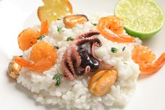Tasty seafood risotto on light background. Closeup Stock Photography