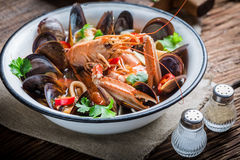 Tasty seafood soup with mussels and langoustines stock photo