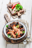 Tasty seafood soup with mussels and shrimps Stock Photo