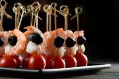 Tasty shrimps appetizer on the dark background Stock Photos