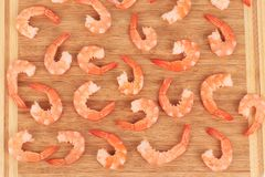 Tasty shrimps on cutting board. Royalty Free Stock Image
