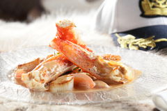 Tasty shrimps on transparent dish Royalty Free Stock Photos